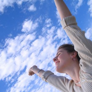 Girl waving her arms to the sky