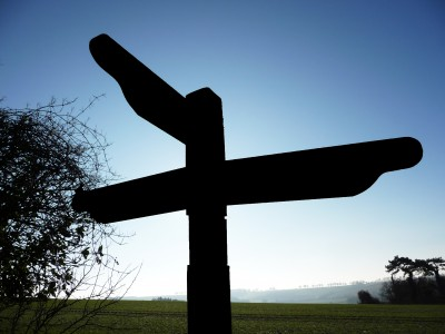 Signpost against a winter sky