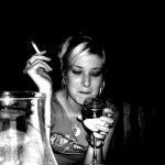 Girl craving alcohol and smoking a cigarette