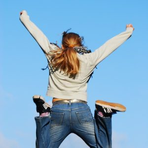 weight loss woman leaping for joy